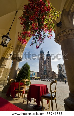 View of the Mariacky church in Krakow, Poland, from a restaurant in Sukiennica