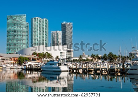 View of the Marina in Miami Bayside with modern buildings and skyline in the background. - stock photo