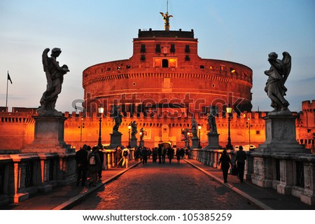 View of the Mausoleum of Hadrian, Saint Angelo castle, Castel Sant'Angelo (Castle of the Holy Angel) from the Ponte Sant'Angelo bridge in Rome, Italy with dusk sky light.  - stock photo
