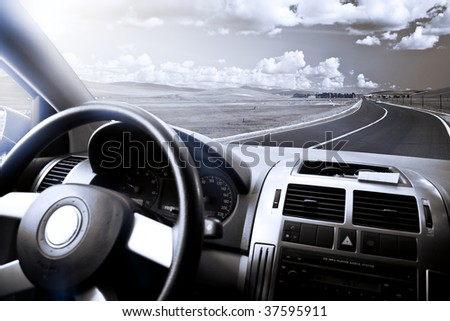 view of the meadow from a car. - stock photo