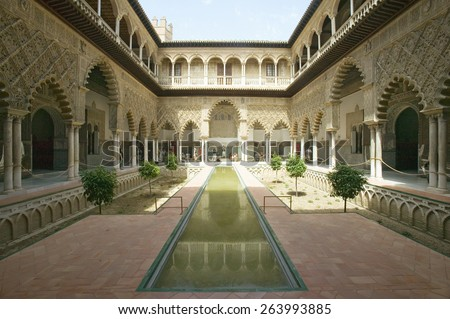 View of the Medieval garden and courtyard, the Patio de las Doncellas, of the Royal Palace, Sevilla, Spain, dating back to the 9th century - stock photo