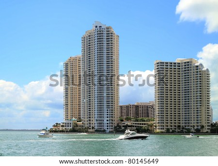 View of the Miami inlet with pleasure boats and downtown Apartments. - stock photo