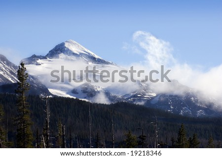View of the Middle Sister in the Cascades Mountain Range on a blustery October day.  Taken from McKenzie Pass Summit, Oregon. - stock photo