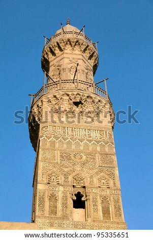 View of the minaret of the Sultan al-Nasir Muhammad ibn Qalawun Mosque in cent of Cairo city, Egypt - stock photo