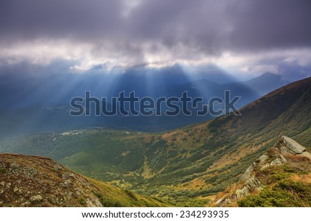 View of the misty landscape with mountains - stock photo