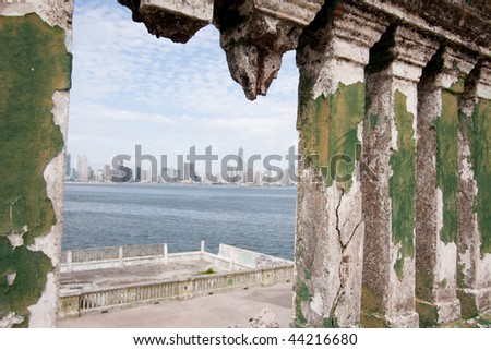 View of the modern skyscrapers of Panama City from inside the ruins of Club de Clases y Tropas in Casco Viejo. Panama City, Panama, Central America. - stock photo