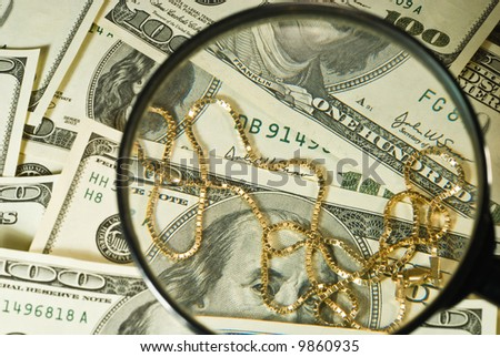 view of the money through a magnifier