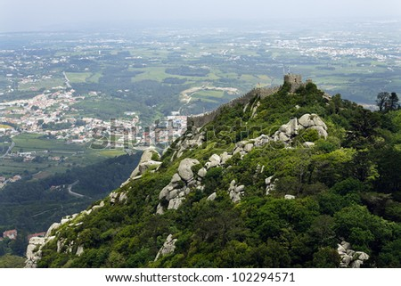 View of the Moors Castle from Palacio da Pena in Sintra, near Lisbon in Portugal. This castle dates from the IX century and is recognised as an UNESCO World Heritage Site since 1995. - stock photo