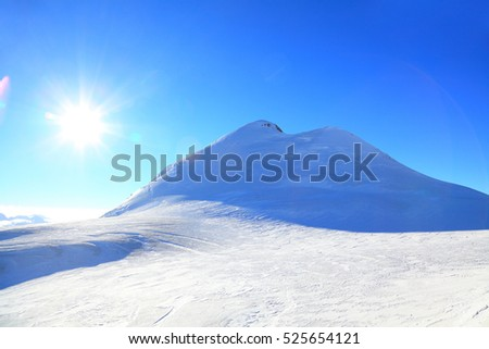 view of the mount Kazbek and bright sun. Caucasus, Russia