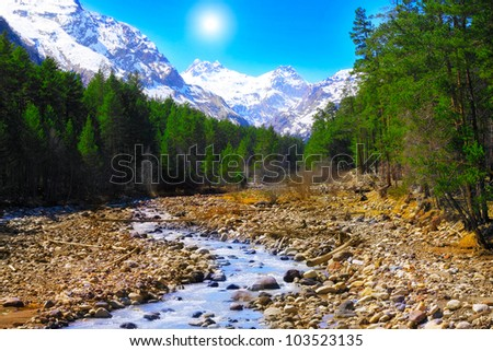 View of the mountains and river into the valley. Elbrus area - stock photo