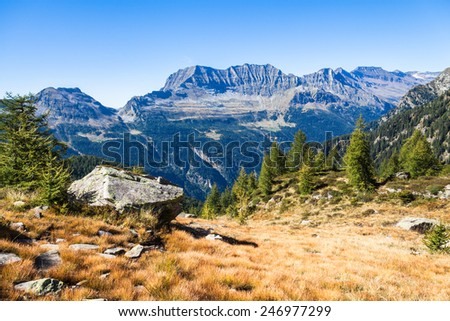 View of the mountains and valley on the hiking trail near Buffalora hut in ticino, Switzerland - stock photo