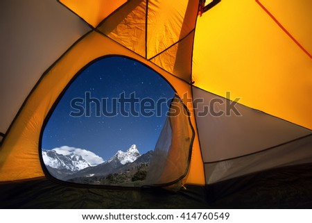 View of the mountains from a tourist tent. From left to right there are two eight-thousanders - Mt. Everest (8,848 m), Lhotse (8,516 m) and Ama Dablam (6,814 m).  - stock photo