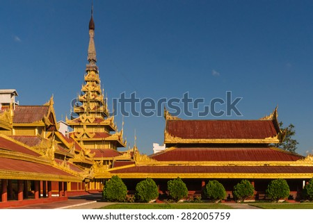 View of the Myey Nan Taw, the building housing the Lion Throne, and other buildings at the Mandalay Royal Palace compound - stock photo