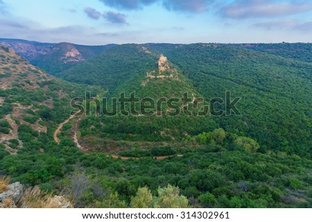View of the Nahal Kziv (Kziv Stream) and the Montfort Castle, a ruined crusader castle in the Upper Galilee region in northern Israel - stock photo