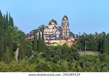 View of the New Athos Monastery (Novy Afon Monastery) with Cathedral of St. Panteleimon the Great Martyr and Belfry, Abkhazia - stock photo