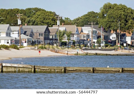 View of the New England coastline with a long row of beach cottages. - stock photo