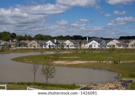 view of the newly build development from the lake - stock photo
