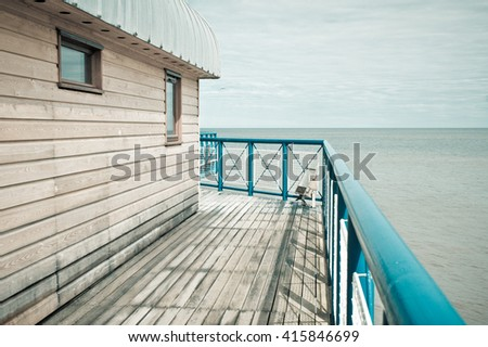 View of the North Sea in the UK from a pier, in muted pastel tones - stock photo