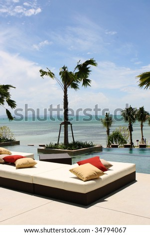 View of the ocean from a tropical resort spa. - stock photo