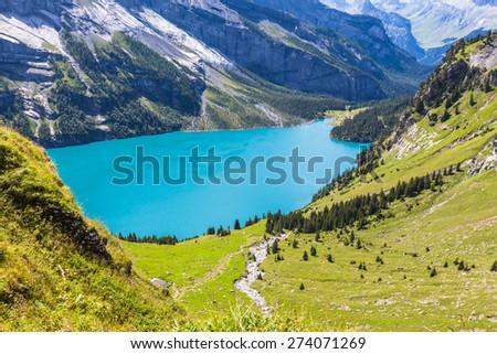 View of the Oeschinensee (Oeschinen lake) near Kandersteg on bernese oberland in Switzerland. - stock photo