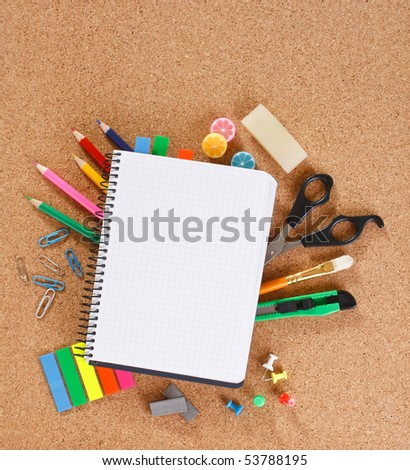 view of the office tools on cork board - stock photo