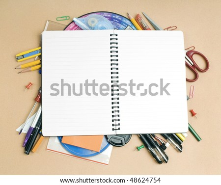 View of the office tools on yellow background - stock photo