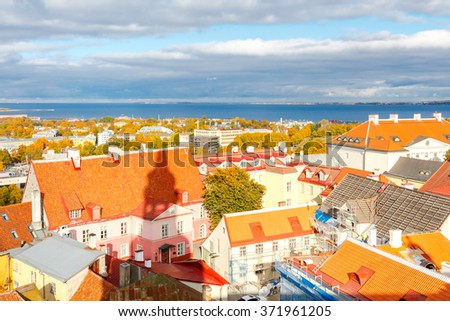 View of the old city streets, roof tops and the bay from the observation deck of the Church of St. Olaf. - stock photo