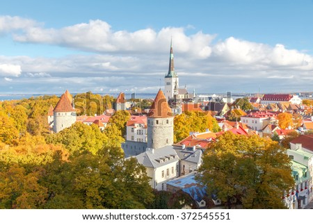 View of the old city streets, roof tops and the bay from the observation deck of the Toompea Hill. - stock photo