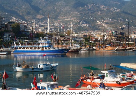 View of the old harbor and the fishing and touristic boats in Alanya. Turkey.
