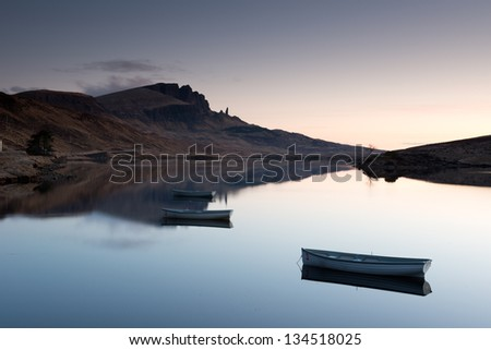 View of the Old Man of Storr over Loch Leathann - stock photo