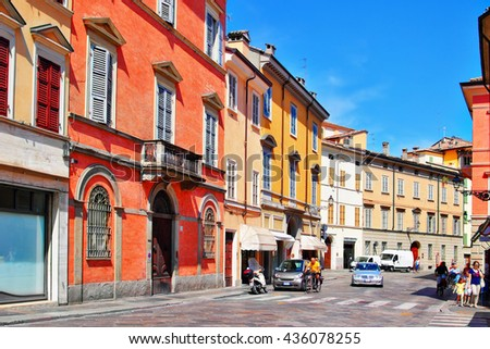 View of the old street Strada Luigi Carlo Farini in Parma, Emilia-Romagna province. Italy. It is one of the oldest Italian towns. - stock photo