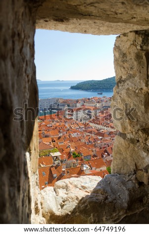 View of the Old Town of Dubrovnik, Croatia From a Stone Window in the Old City Walls - stock photo