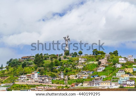 View of the old town of Quito, Ecuador with rolling hills in the background