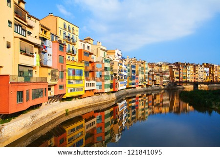 View of the old town with colorful houses reflected in water (Jewish quarter in Girona. Catalonia. Spain.) - stock photo