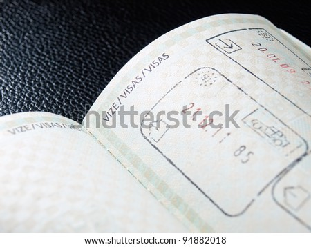 View of the open passport and space provided for visas and stamps... - stock photo