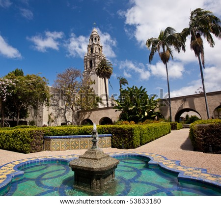View of the ornate California Tower from the Alcazar Gardens with fountain in foreground in Balboa Park in San Diego - stock photo