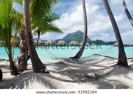 View of the Otemanu mountain ,  the palms with hammock and the lagoon , Bora Bora , French Polynesia , South Pacific ocean - stock photo