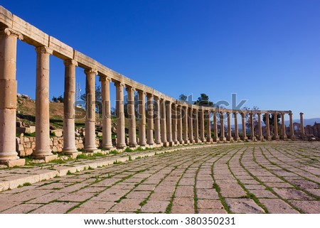 View of the Oval Forum colonnade in ancient Jerash, Jordan - stock photo
