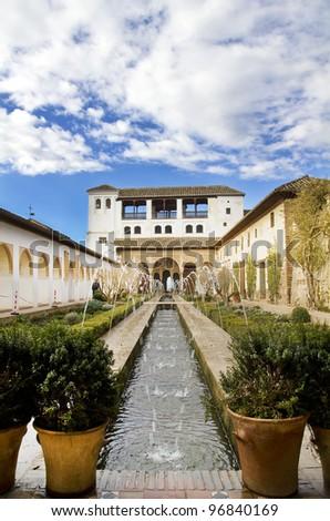 View of the Patio de la Acequia in the Palacio del Generalife, part of the La Alhambra complex in Granada, Spain. - stock photo