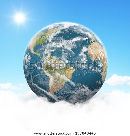 View of the planet Earth on fluffy clouds - stock photo
