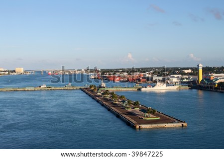 View of the port of Nassau with bridge to Paradise Island in the background and cruise ship docks in the forefront - stock photo