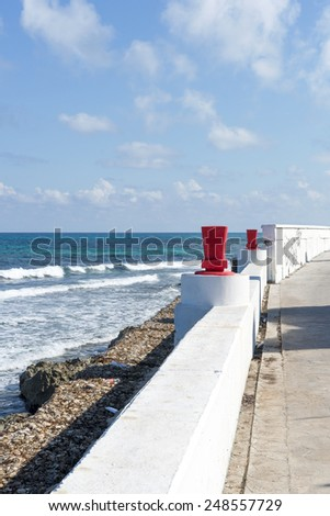 View of the promenade on the eastern shore of the ocean in Isla Mujeres, Mexico. The island is located 8 miles east of Cancun in the Gulf of Mexico. - stock photo