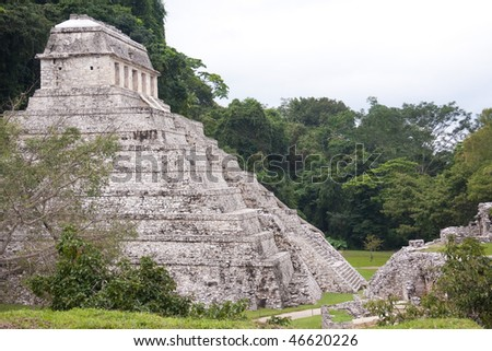View of the pyramid,'Temple of Inscriptions' with jungle in background in the ancient Mayan city of Palenque. Chiapas, Central America. - stock photo