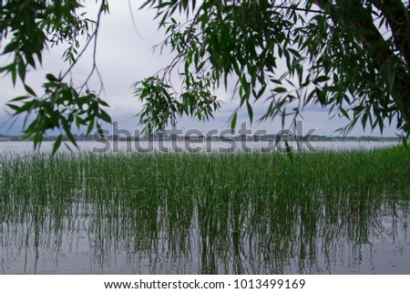 View of the river bay during the rain. Tourist base in the forest. Ulyanovsk Region, Russia.