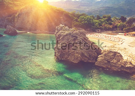 View of the rocks at the beach. Montenegro. The island of St. Nicholas. Adriatic Sea. Filtered image:cross processed vintage effect.  - stock photo