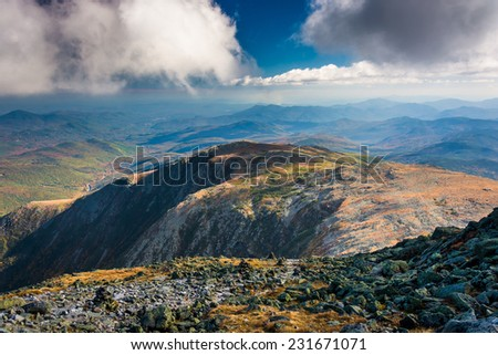 View of the rocky, rugged White Mountains from the summit of Mount Washington, New Hampshire. - stock photo