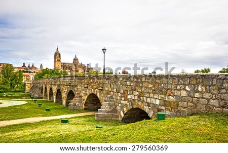View of The Roman Bridge and The New Cathedral of Salamanca, Castilla y Leon, Spain - stock photo