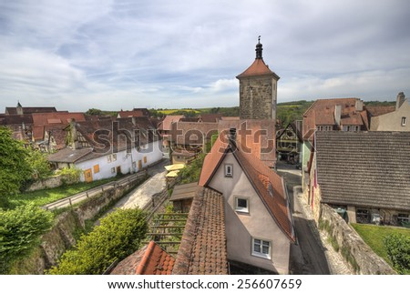 View of the roofs and tower of Rothenburg ob der Tauber, Germany, from the ancient city wall - stock photo