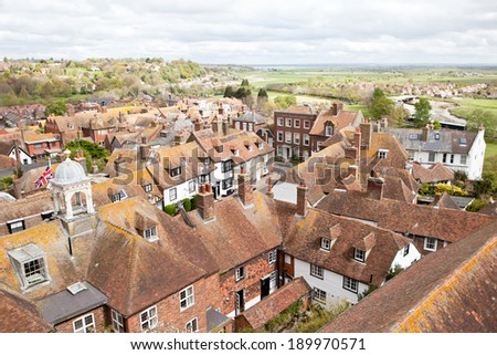 View of the rooftops of the historic Cinque Port town of Rye in East Sussex, South coast, England from the top of Saint Mary's Church Tower. - stock photo
