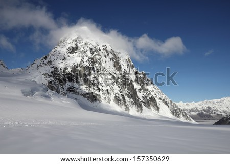 View of the Royal Tower Rock Formation after Landing on the Pika Glacier in Denali National Park, Alaska - stock photo